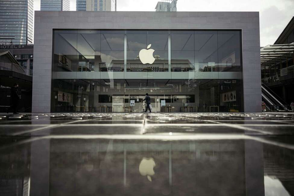 FILE -- A shopper wearing a protective face mask walks past an empty Apple store in Taikoo Li, a normally bustling shopping area in Chengdu, China, on Thursday, Feb. 6, 2020. Apple said on Feb. 17, that it was cutting its sales expectations because of the coronavirus in China, in a sign of how the outbreak has hit global business and is set to exact a steep toll. (Yuyang Liu/The New York Times)