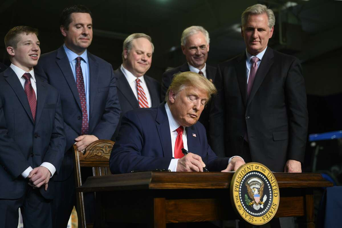 US President Donald Trump signs a memorandum after delivering remarks to Rural Stakeholders on California Water Accessibility in Bakersfield, California, on February 19, 2020.