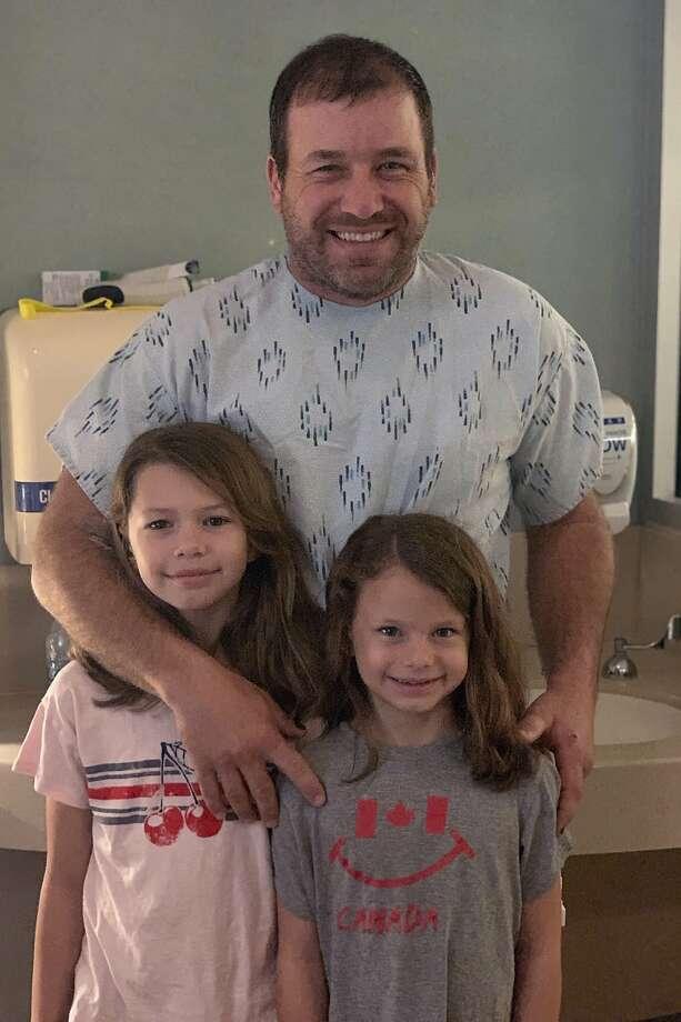 Ryan Newman and his daughters, Brooklyn Sage, left, and Ashlyn Olivia, at Halifax Medical Center in Daytona Beach, Fla. Photo: Associated Press Via Roush Racing