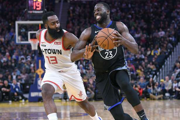 SAN FRANCISCO, CALIFORNIA - DECEMBER 25: Draymond Green #23 of the Golden State Warriors drives towards the basket on James Harden #13 of the Houston Rockets during the second half of an NBA basketball game at Chase Center on December 25, 2019 in San Francisco, California. NOTE TO USER: User expressly acknowledges and agrees that, by downloading and or using this photograph, User is consenting to the terms and conditions of the Getty Images License Agreement. (Photo by Thearon W. Henderson/Getty Images)