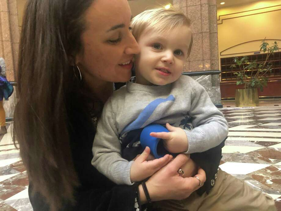 Gabrielle Sellari, of Shelton, and her son Gianluca, who will be 2 years old next month, at the state Legislative Office Building for a public hearing on a bill that would eliminate the non-medical exemption for vaccinations. Photo: Kaitlyn Krasselt / Hearst Connecticut Media