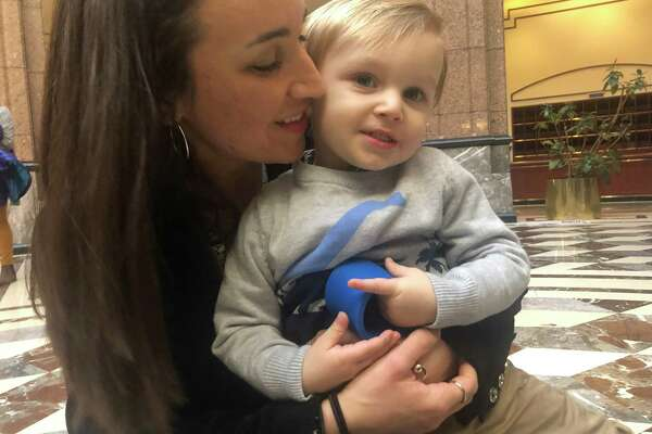 Gabrielle Sellari, of Shelton, and her son Gianluca, who will be 2 years old next month, at the state Legislative Office Building for a public hearing on a bill that would eliminate the non-medical exemption for vaccinations.