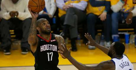 PJ Tucker #17 of the Houston Rockets shoots the ball over Draymond Green #23 of the Golden State Warriors during Game Five of the Western Conference Semifinals of the 2019 NBA Playoffs at ORACLE Arena on May 08, 2019 in Oakland, California. (Photo by Lachlan Cunningham/Getty Images)