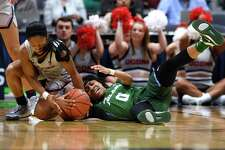Tulane's Arsula Clark, right, is pressured by Connecticut's Crystal Dangerfield, left, in the first half of an NCAA college basketball game, Wednesday, Feb. 19, 2020, in Hartford, Conn. (AP Photo/Jessica Hill)