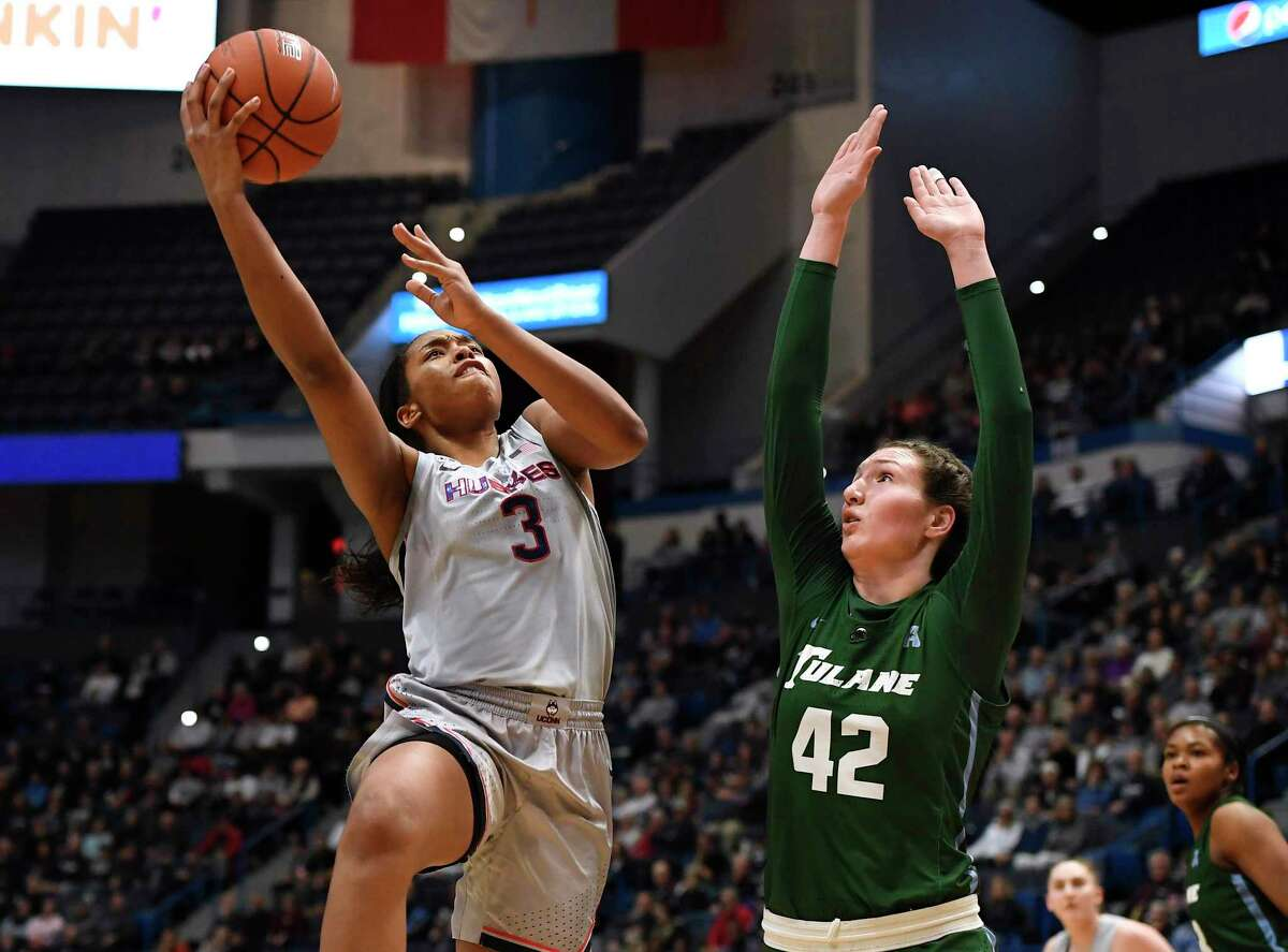 UConn's Megan Walker shoots over Tulane's Mia Heide in the first half during a game in February in Hartford.