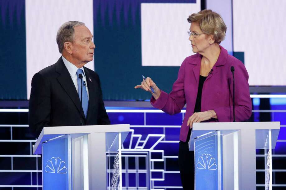 Democratic presidential candidates, former New York City Mayor Mike Bloomberg, left, and Sen. Elizabeth Warren, D-Mass., talk before a Democratic presidential primary debate Wednesday, Feb. 19, 2020, in Las Vegas, hosted by NBC News and MSNBC. Photo: John Locher, AP / Copyright 2020 The Associated Press. All rights reserved