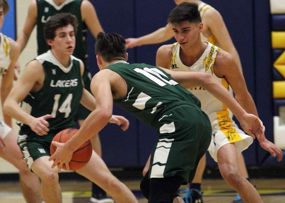 The Bad Axe boys basketball team ran past visiting Laker, 59-45, on Wednesday night. Photo: Mark Birdsall/Huron Daily Tribune