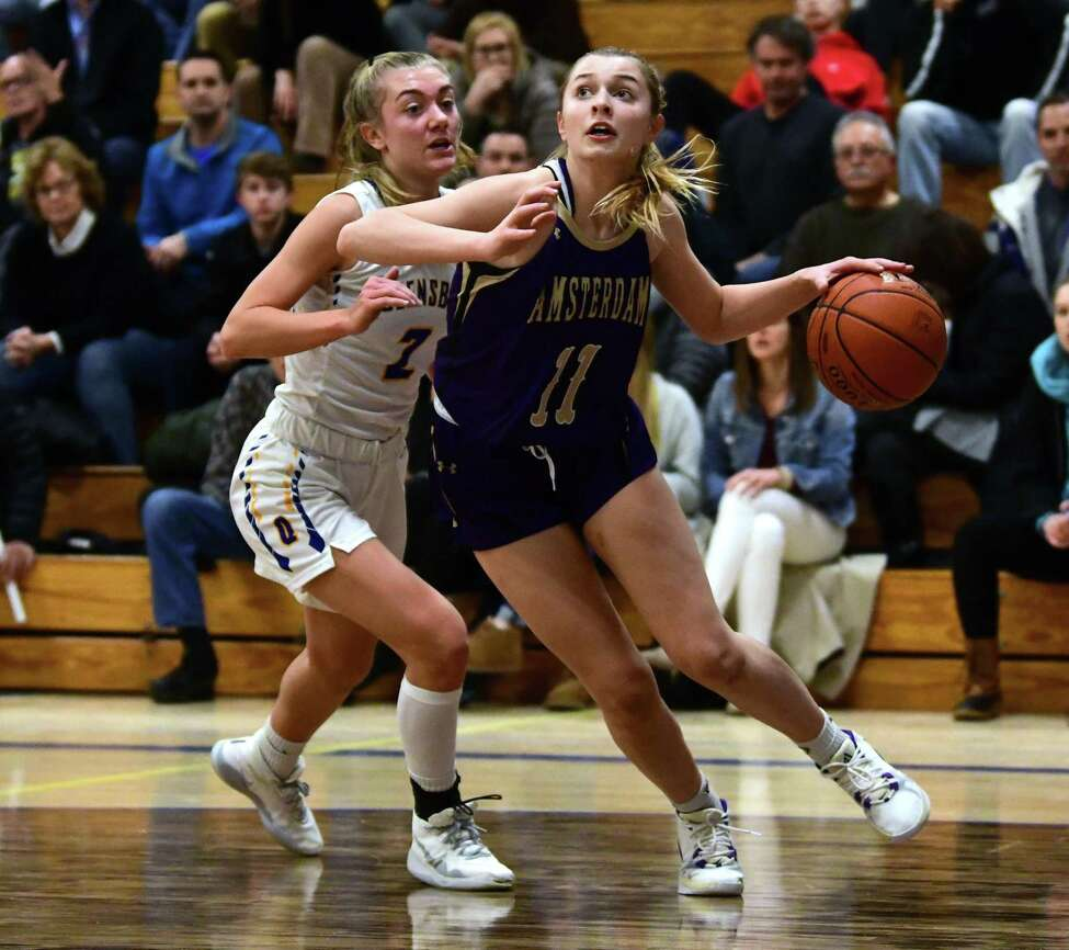 Amsterdam's Andie Gannon drives to the hoop against Queensbury's Meghan O' Connor during a basketball game on Monday, Jan. 6, 2020 in Queensbury, N.Y. (Lori Van Buren/Times Union)