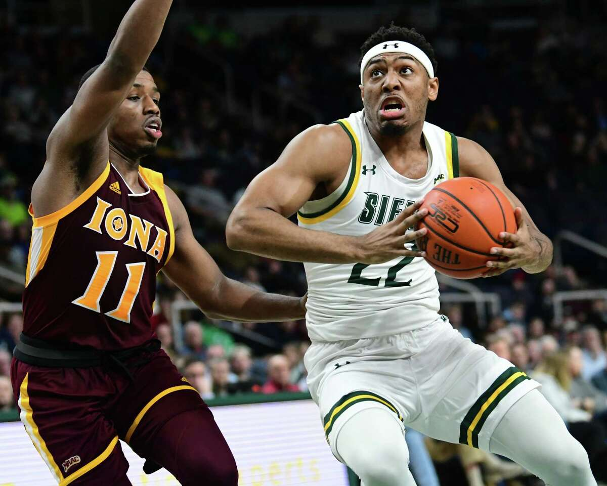 Siena's Jalen Pickett drives to the basket against Iona's Isaiah Washington during a basketball game at the Times Union Center on Wednesday, Feb. 19, 2020 in Albany, N.Y. (Lori Van Buren/Times Union)