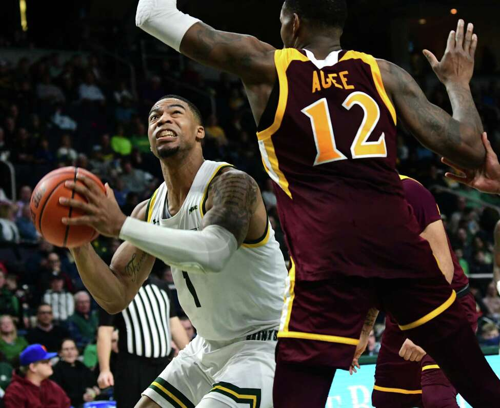 Siena's Elijah Burns drives to the basket against Iona's Tajuan Agee during a basketball game at the Times Union Center on Wednesday, Feb. 19, 2020 in Albany, N.Y. (Lori Van Buren/Times Union)