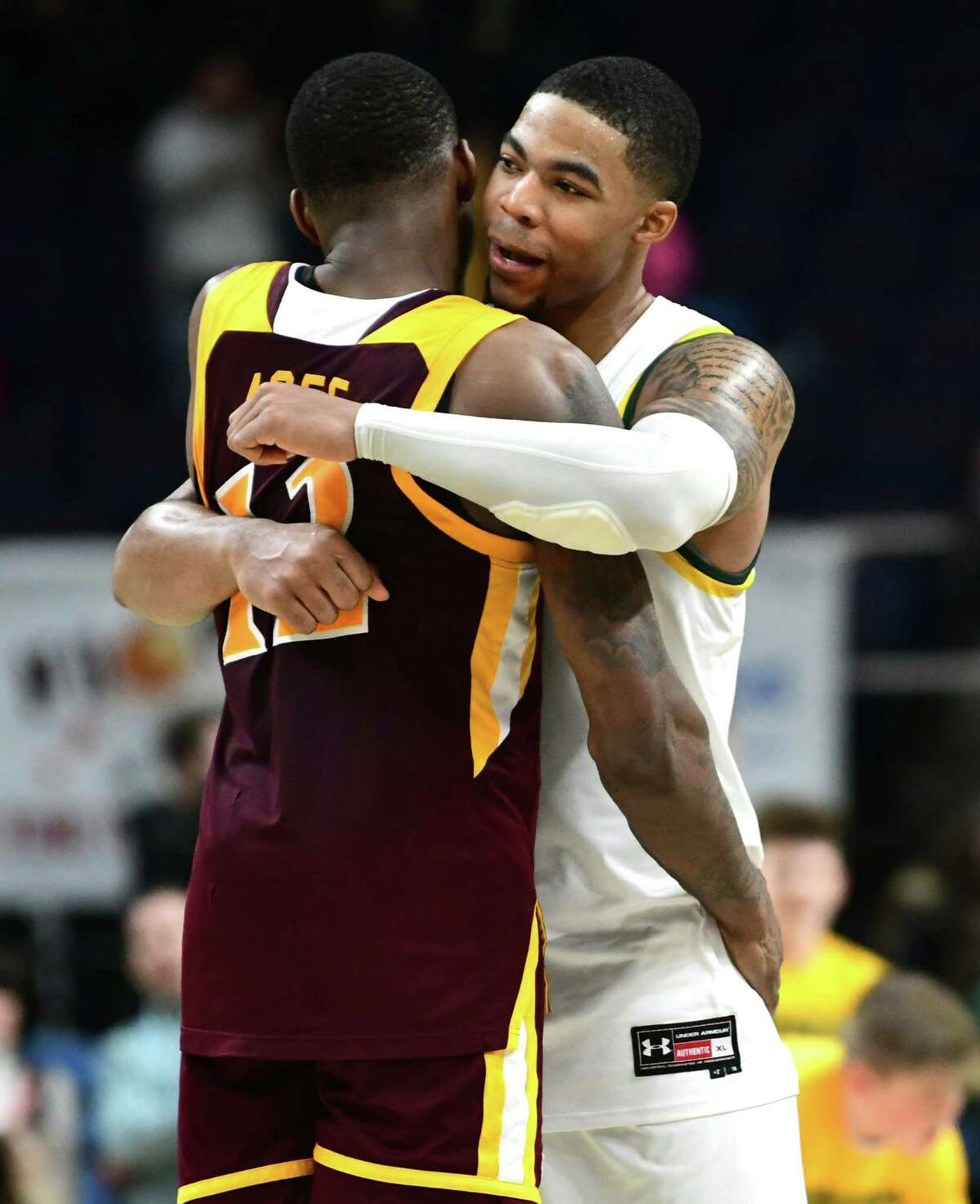 Siena's Elijah Burns, right, hugs Iona's Tajuan Agee after Siena's win at the Times Union Center on Wednesday, Feb. 19, 2020 in Albany, N.Y. (Lori Van Buren/Times Union)