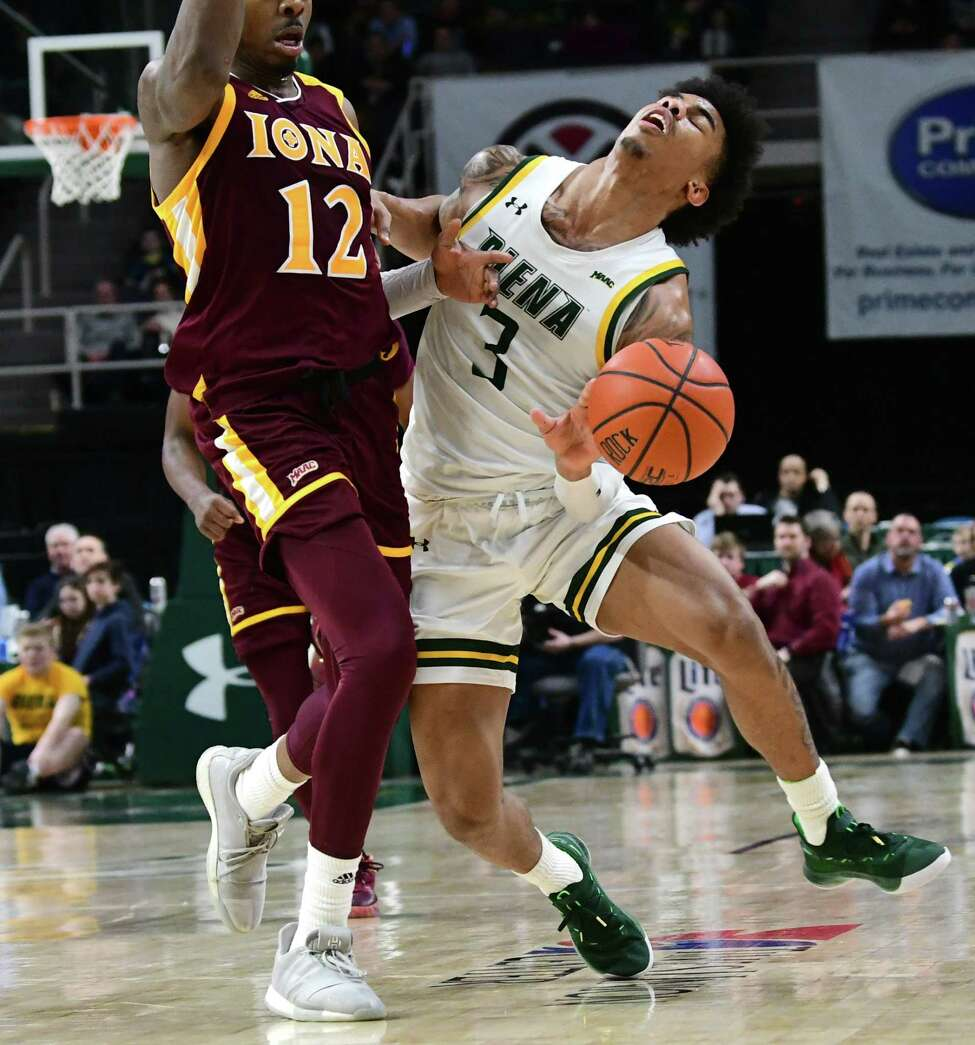 Siena's Manny Camper is fouled by Iona's Tajuan Agee during a basketball game at the Times Union Center on Wednesday, Feb. 19, 2020 in Albany, N.Y. (Lori Van Buren/Times Union)