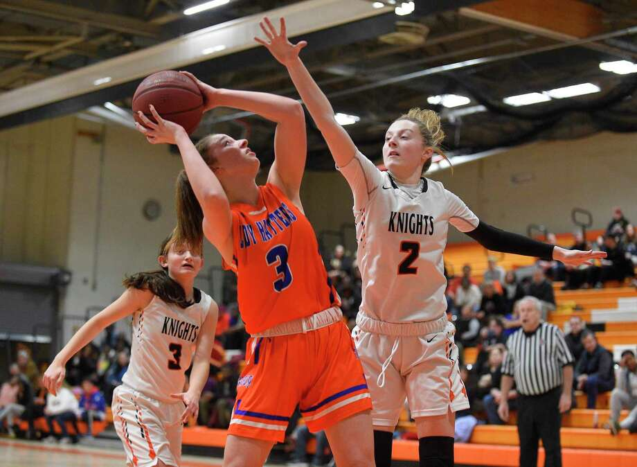 Danbury's Chloe Perreault (3) is pressured by Stamford's Megan Landsiedel in the first half on Wednesday. Photo: Matthew Brown / Hearst Connecticut Media / Stamford Advocate