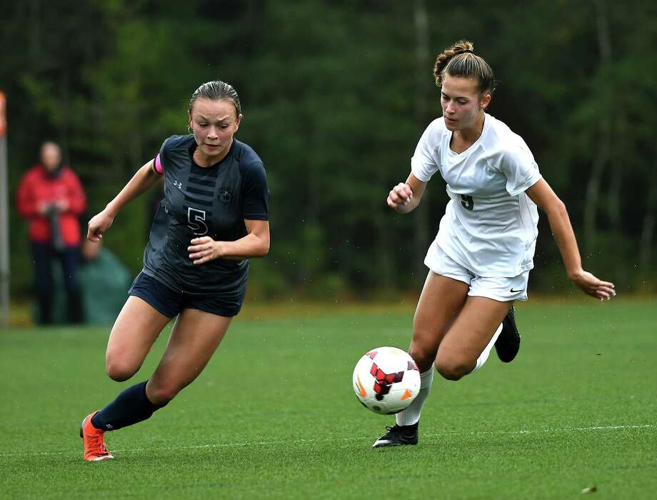 The Woodlands Emily Bates (9), shown here earlier this season, scored a goal in Wednesday's game at Klein Forest. Photo: Jerry Baker, Houston Chronicle / Contributor / Houston Chronicle