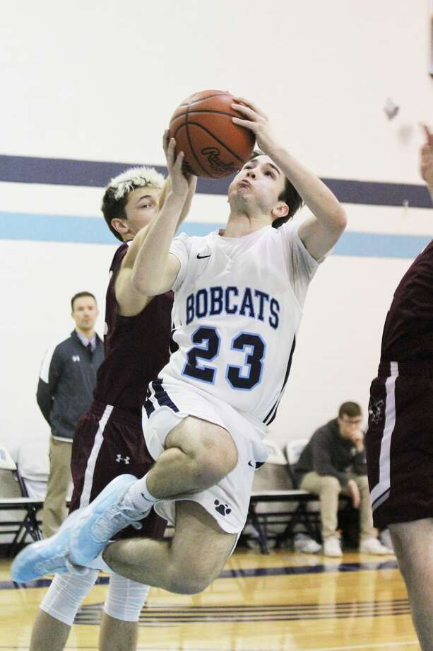 Brethren's Tyler Guinan goes up for a layup during the Bobcats' victory over Marion on Wednesday. Photo: Dylan Savela/News Advocate
