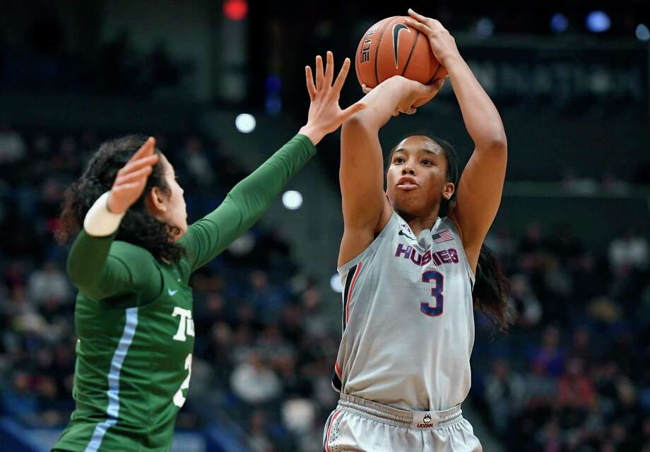 UConn's Megan Walker, right, shoots over Tulane's Irina Parau in the second half during a game in February. Photo: Jessica Hill / Associated Press / Copyright 2020 The Associated Press. All rights reserved.
