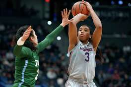 UConn's Megan Walker, right, shoots over Tulane's Irina Parau in the second half during a game in February.