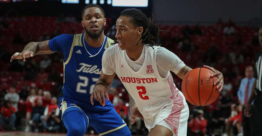 Houston Cougars guard Caleb Mills (2) drives around Tulsa Golden Hurricane guard Reggie Jones (22) during the first half of an NCAA basketball game at Fertitta Center Wednesday, Feb. 19, 2020, in Houston. Photo: Steve Gonzales/Staff Photographer