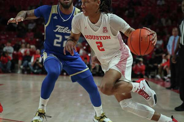 On his way to a 27-point game, UH guard Caleb Mills blows past Tulsa guard Reggie Jones during the first half Wednesday night.