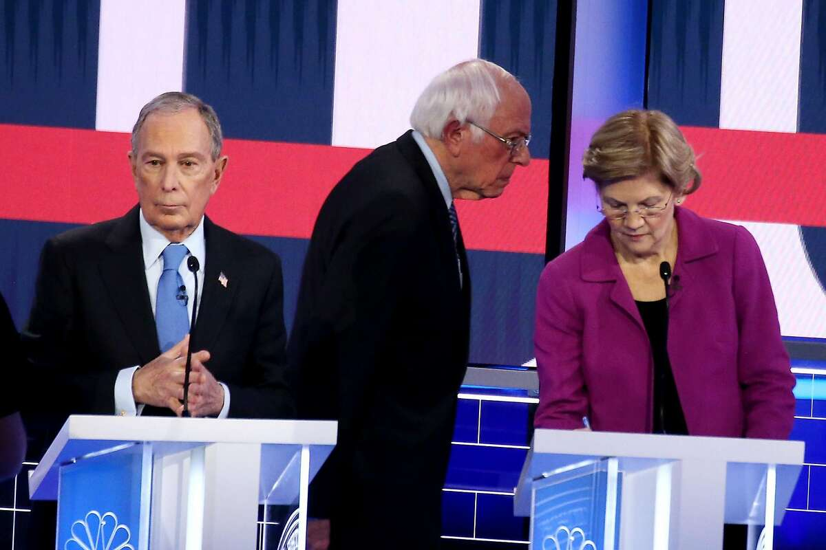 LAS VEGAS, NEVADA - FEBRUARY 19: Democratic presidential candidates (L-R) former New York City Mayor Mike Bloomberg, Sen. Bernie Sanders (I-VT) and Sen. Elizabeth Warren (D-MA) take a break during the Democratic presidential primary debate at Paris Las Vegas on February 19, 2020 in Las Vegas, Nevada. Six candidates qualified for the third Democratic presidential primary debate of 2020, which comes just days before the Nevada caucuses on February 22. (Photo by Mario Tama/Getty Images)