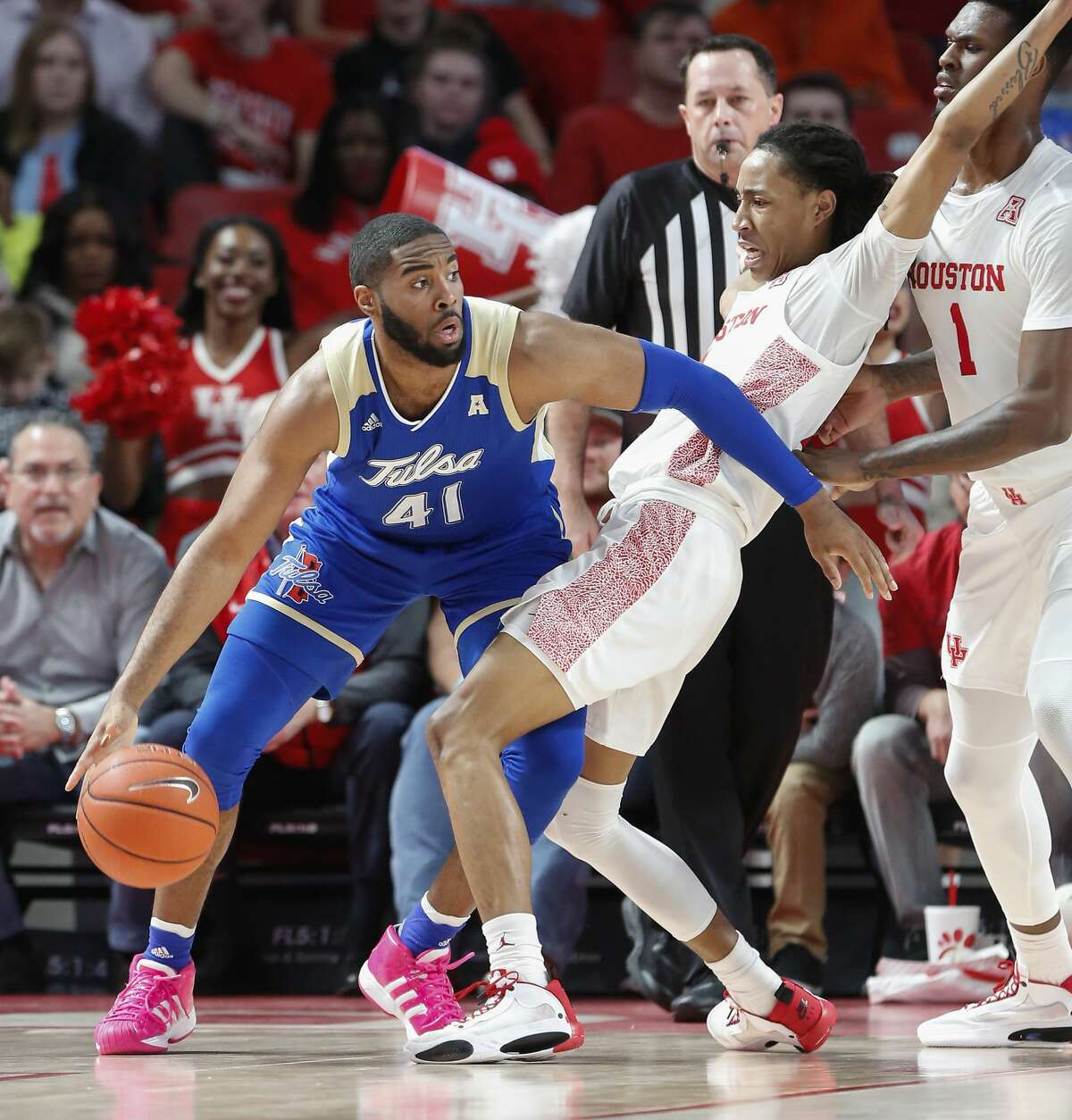 Tulsa Golden Hurricane forward Jeriah Horne (41) uses his arm to get around Houston Cougars guard Caleb Mills (2) during the first half of an NCAA basketball game at Fertitta Center Wednesday, Feb. 19, 2020, in Houston.