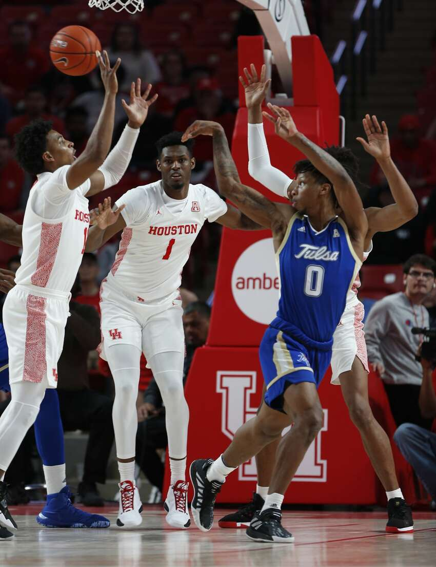 Tulsa Golden Hurricane guard Brandon Rachal (0) passes out of trap by Houston Cougars players during the first half of an NCAA basketball game at Fertitta Center Wednesday, Feb. 19, 2020, in Houston.