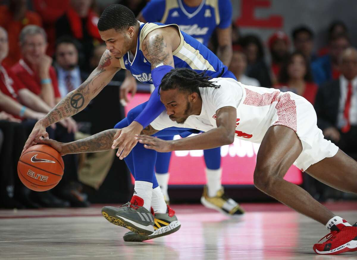 Tulsa Golden Hurricane guard Elijah Joiner (3) and Houston Cougars guard DeJon Jarreau (3) battle for the ball during the first half of an NCAA basketball game at Fertitta Center Wednesday, Feb. 19, 2020, in Houston.