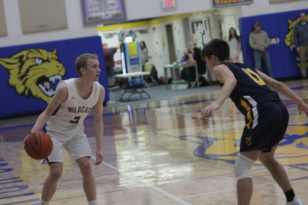 Roscommon's boys basketball team held back Evart 47-44 in Highland Conference action on Wednesday.