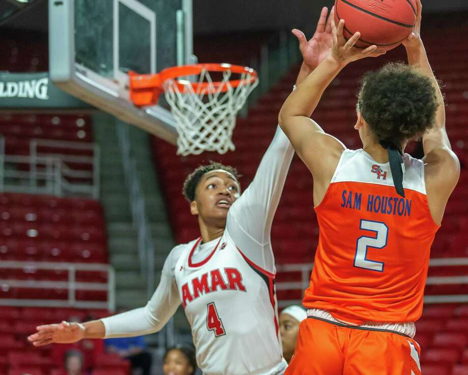 Briana Laidler (4) defends against Amber Leggett (2) as the Bearkats of Sam Houston State came to the Montagne Center to battle with the Lady Cardinals on Thursday, February 19, 2020. Fran Ruchalski/The Enterprise Photo: Fran Ruchalski/The Enterprise / 2019 The Beaumont Enterprise