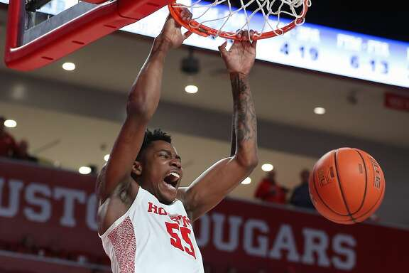 Houston Cougars center Brison Gresham (55) slam dunks the ball during the second half of an NCAA basketball game at Fertitta Center Wednesday, Feb. 19, 2020, in Houston.