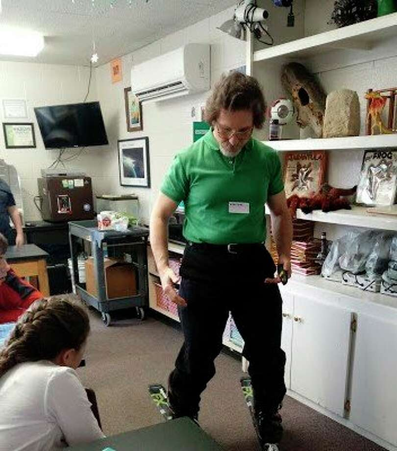 Dr. Edmund Stark, a researcher from MSU St. Andrews, gives St. John's Lutheran School students a demonstration of the physics of skiing. (Photo provided)