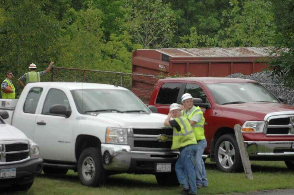 Crews look over a train derailment at the CSX rail line in Ravena, NY, on Monday, Aug. 16, 2010. (Paul Buckowski / Times Union)
