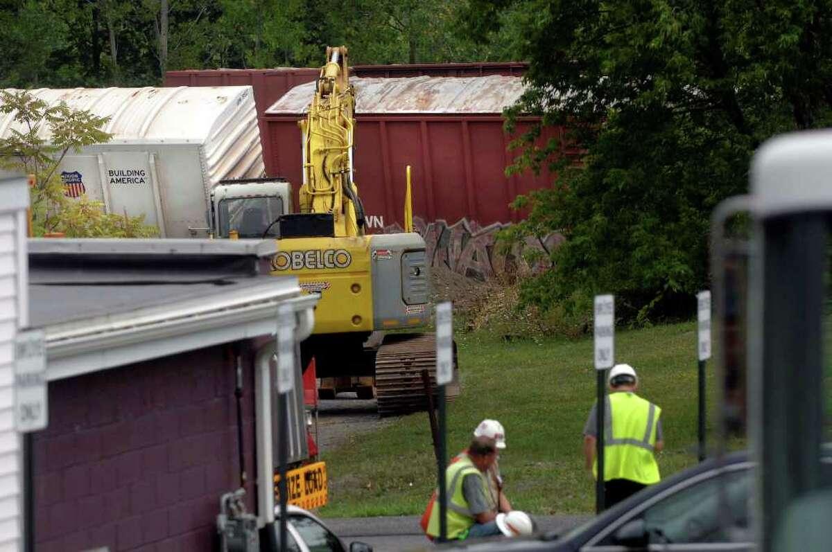 Crews examine a train derailment at the CSX rail line in Ravena, NY, on Monday, Aug. 16, 2010. (Paul Buckowski / Times Union)