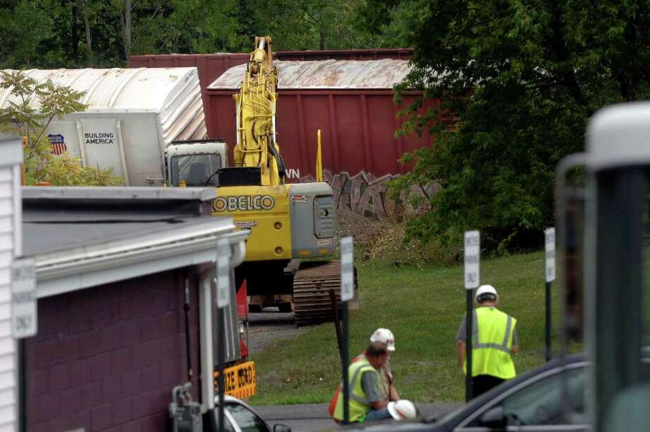Crews examine a train derailment at the CSX rail line in Ravena, NY, on Monday, Aug. 16, 2010.   (Paul Buckowski / Times Union) Photo: Paul Buckowski / 00009880A