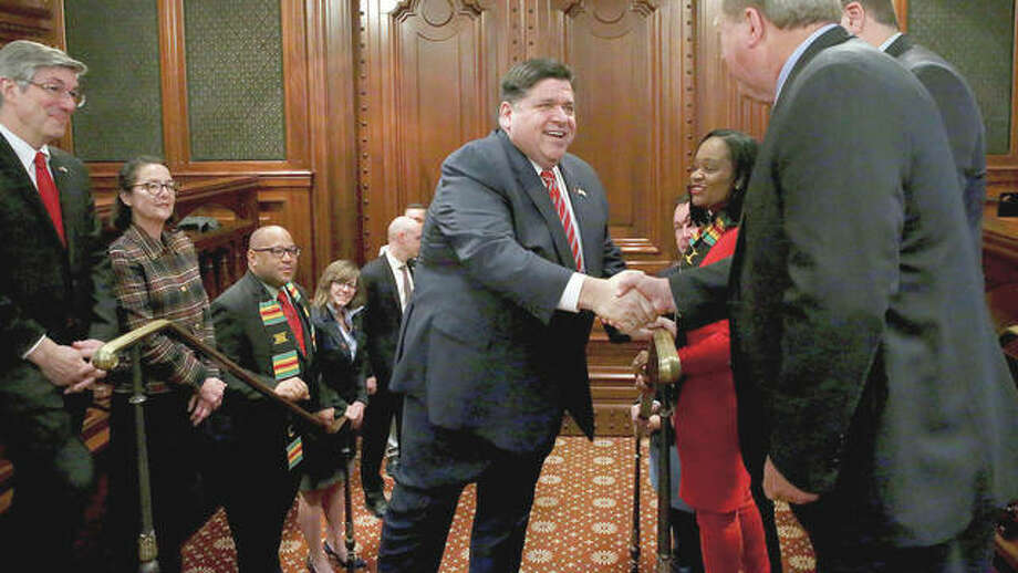 Gov. J.B. Pritzker arrives Wednesday for his state budget address at the Capitol in Springfield. Photo: Antonio Perez | Chicago Tribune (AP)