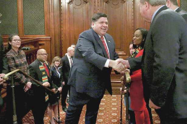 Gov. J.B. Pritzker arrives Wednesday for his state budget address at the Capitol in Springfield.