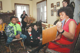 """Lt. Gov. Juliana Stratton reads the children's book """"Henry's Freedom Box"""" to students during a visit Wednesday to Woodlawn Farm. Stratton's visit to the historic Underground Railroad site east of Jacksonville was one of several she is making in observance of Black History Month."""