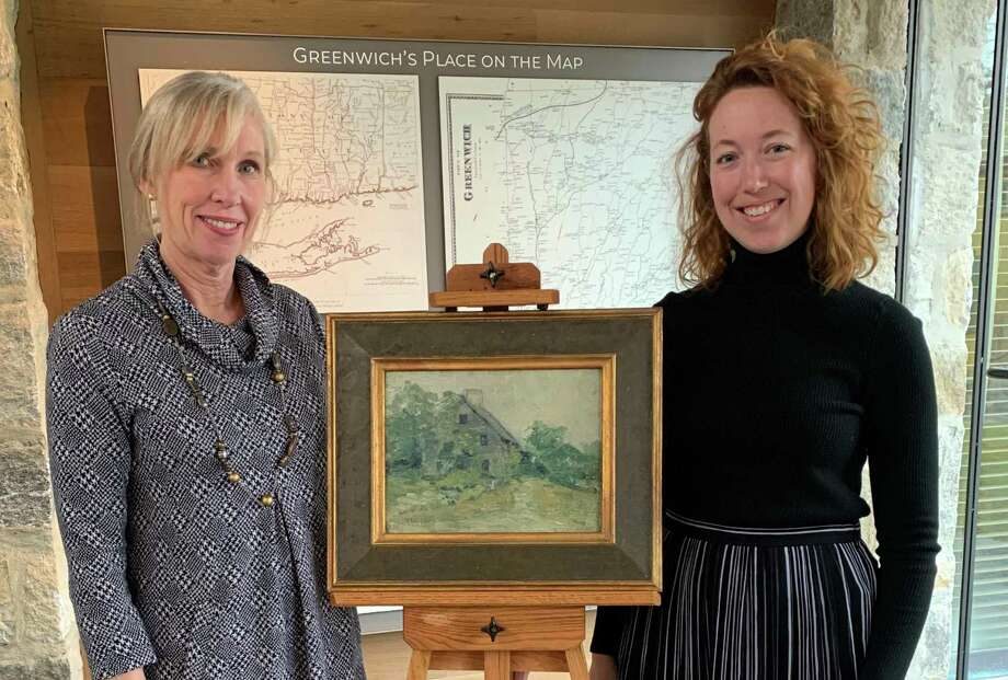 """Greenwich Historical Society Executive Director & CEO Debra Mecky and Curator of Museum Collections Maggie Dimock with the """"Old Salt Box"""" by John Henry Twachtman. The painting was given to the Greenwich Historical Society by Raymond and Margaret Horowitz in 1988. The Mr. and Mrs. Raymond J. Horowitz Foundation for the Arts has announced a grant to fund John Henry Twachtman Online, a joint project of the Greenwich Historical Society and Lisa N. Peters, PhD. Photo: Contributed /"""
