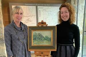 "Greenwich Historical Society Executive Director & CEO Debra Mecky and Curator of Museum Collections Maggie Dimock with the ""Old Salt Box"" by John Henry Twachtman. The painting was given to the Greenwich Historical Society by Raymond and Margaret Horowitz in 1988. The Mr. and Mrs. Raymond J. Horowitz Foundation for the Arts has announced a grant to fund John Henry Twachtman Online, a joint project of the Greenwich Historical Society and Lisa N. Peters, PhD."