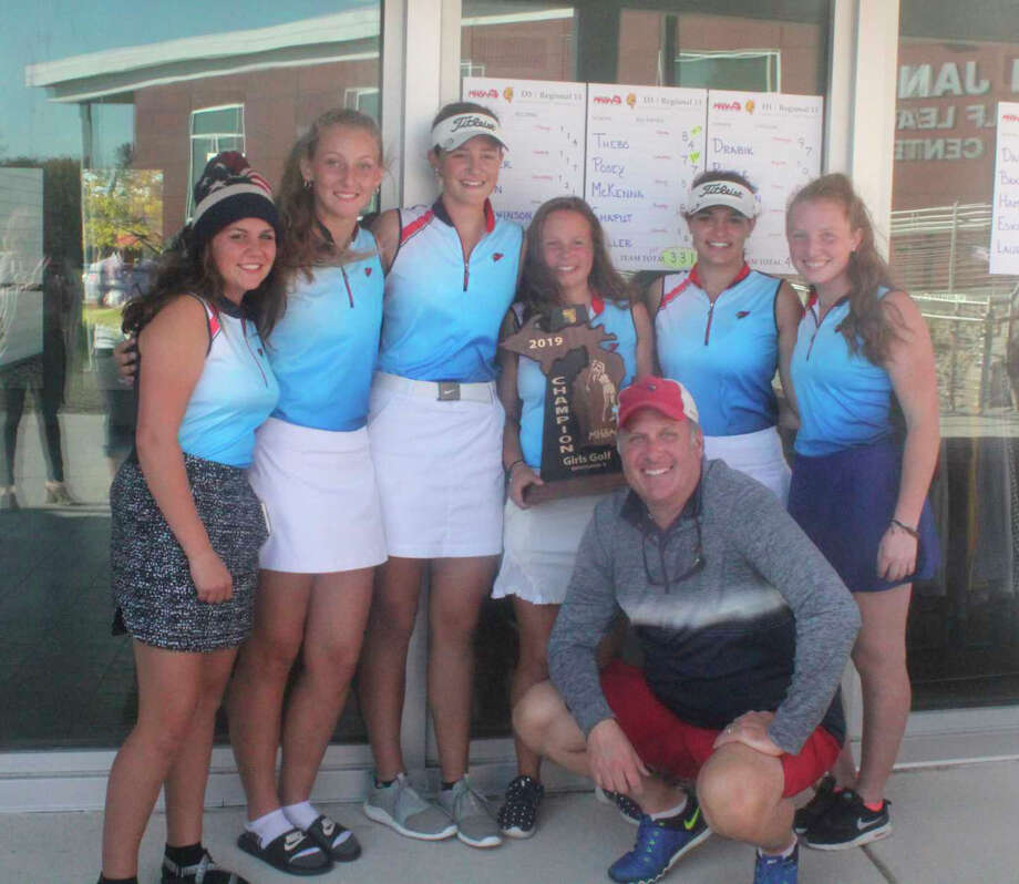 Big Rapids golf coach Mark Posey (front) poses with his girls team last fall after the Cardinals won a regional title. Photo: Pioneer File Photo