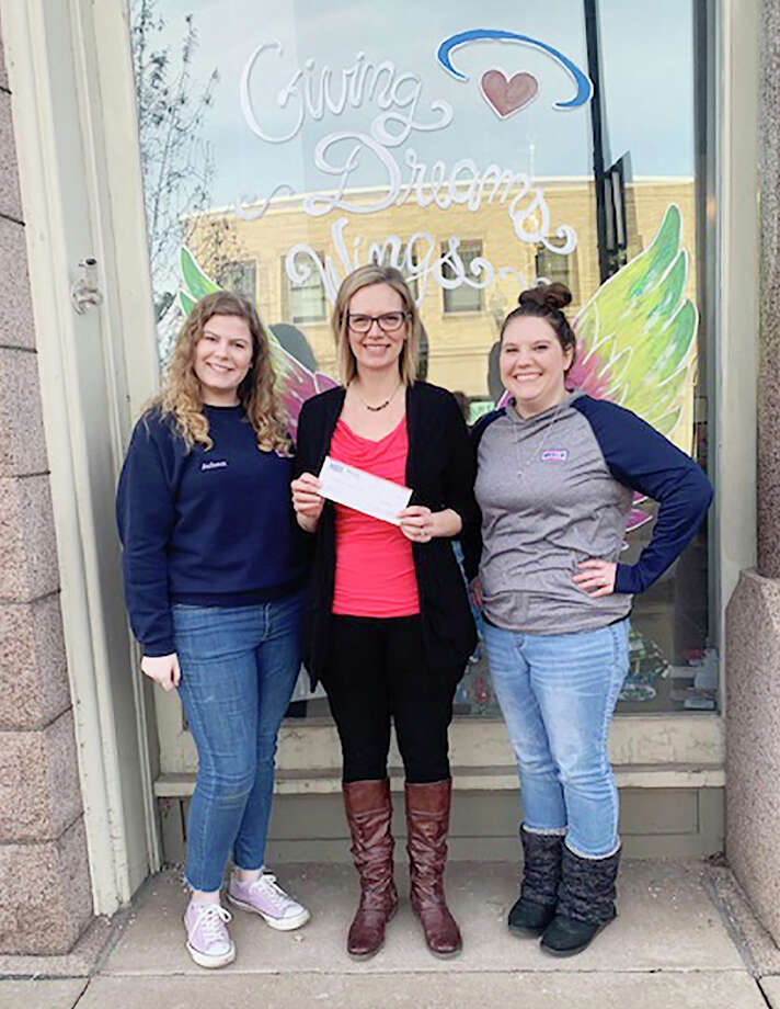Wesco manager Alannah Mourer and employee Autumn Johnson recently dropped a $1,619.98 check off at the Angels of Action office. From left, Johnson, Angels of Action director of operations Jayme Smith and Mourer. Photo: Courtesy Photo