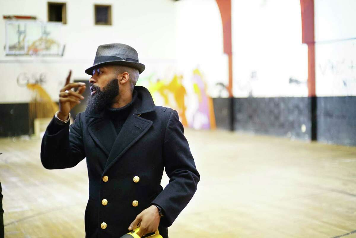 Travon Jackson, president and managing director of BlueLight Development Group, talks about plans for the building while giving a tour inside the former Carver Community Center on Wednesday, Feb. 19, 2020, in Schenectady, N.Y. The group Miracle on Craig Street recently purchased the building with plans to open it as a community center again. BlueLight is the development consultant on the project. (Paul Buckowski/Times Union)
