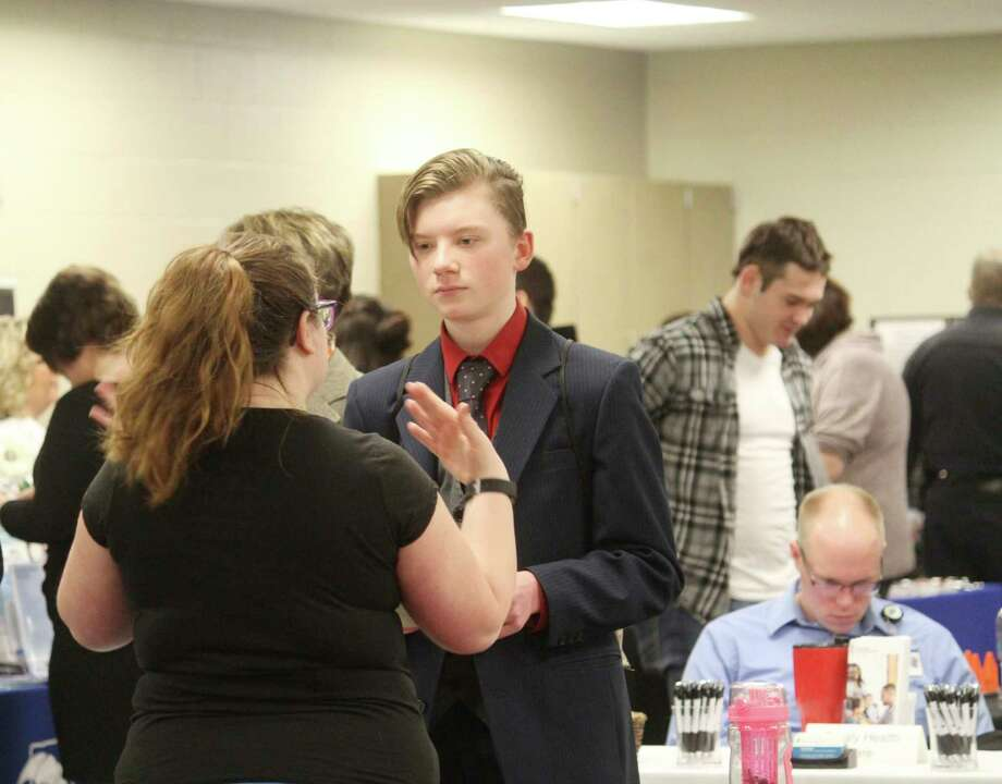 A student talks with a local business representative during the Career Expo. There were about 60 employers at this year's event. (Pioneer photo/Catherine Sweeney)