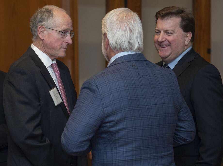 U.S. Rep. Mike Conaway, left, talks with Pat Bond, center, and Kirk Edwards at the Permian Basin Water in Energy Conference dinner Feb. 19 at the Petroleum Club.   Photo: Tim Fischer/Midland Reporter-Telegram