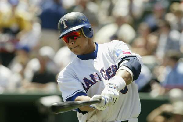 ARLINGTON, TX - APRIL 24: Alex Rodriguez #3 of the Texas Rangers takes a swing during the game against the Boston Red Sox at the Ballpark in Arlington on April 24, 2003 in Arlington, Texas. The Rangers defeated Red Sox 16-5. (Photo by Ronald Martinez/Getty Images)