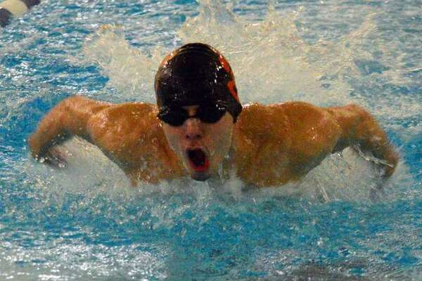 Edwardsville's Logan Mills swims in the 200-yard medley relay during the Southern Illinois High School Boys Championships on Feb. 13 at Chuck Fruit Aquatic Center.