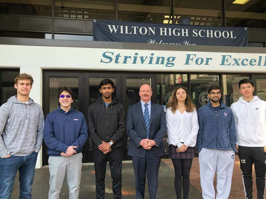 From left are Maden Herve, Alexander Koutsoukos, Vignesh Subramanian, Principal Robert O'Donnell, Ashleigh Coltman, Rishabh Raniwala and Jeffrey Huang at Wilton High School. Photo: Contributed Photo / Wilton High School / Wilton Bulletin Contributed