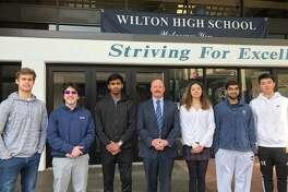 From left are Maden Herve, Alexander Koutsoukos, Vignesh Subramanian, Principal Robert O'Donnell, Ashleigh Coltman, Rishabh Raniwala and Jeffrey Huang at Wilton High School.
