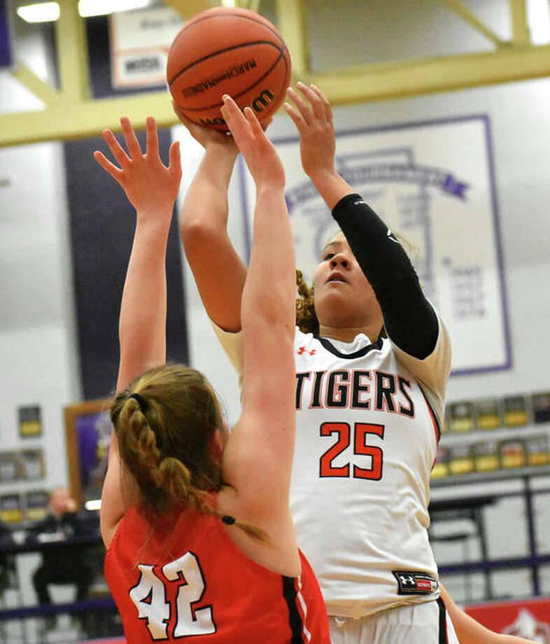 Edwardsville's Sydney Harris (25) shoots over Pekin's Natalie Righi in the Tigers' victory Wednesday night in a semifinal at the Collinsville Class 4A Regional at Fletcher Gym. The Tigers play the host Kahoks for the regional title Friday night. Photo: Matt Kamp / Hearst Midwest