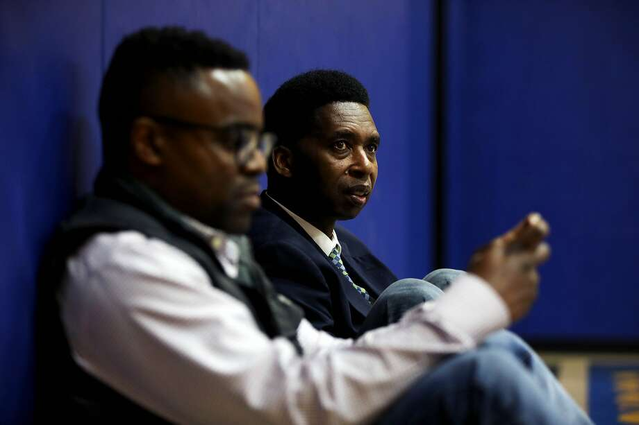 San Francisco documentary filmmaker Kevin Epps converses with his friend, AJ Burleson, left, as Epps attends his son's, Kamari Epps, 9, not pictured, basketball practice at Bayview Hunters Point YMCA in San Francisco, Calif., on Wednesday, January 8, 2020. Epps was held to answer on murder and other charges last month in San Francisco Superior Court after a star witness for the prosecution recounted the details of what happened during a fatal shooting inside a Diamond Heights apartment in 2016. Epps is out on bail after a judge determined he was not a threat to the community and his case is being closely watched by advocates, especially in Bayview Hunters Point where Epps grew up. Photo: Yalonda M. James / The Chronicle